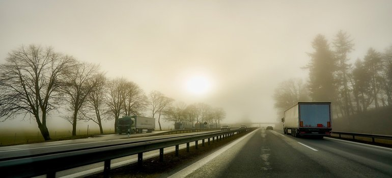 A truck driving on a foggy road