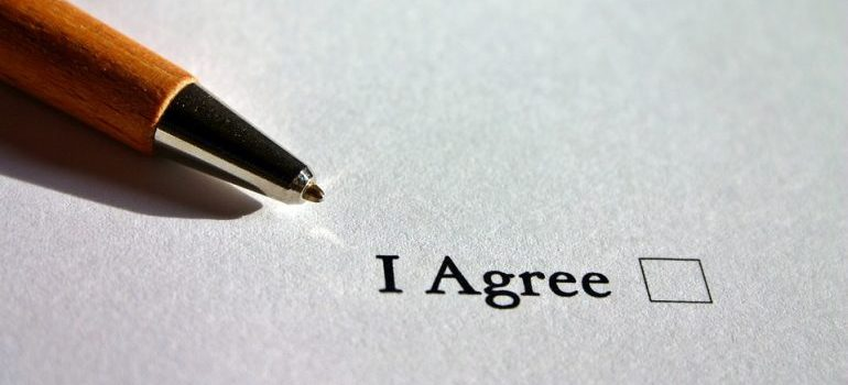 An I agree sign on a contract.