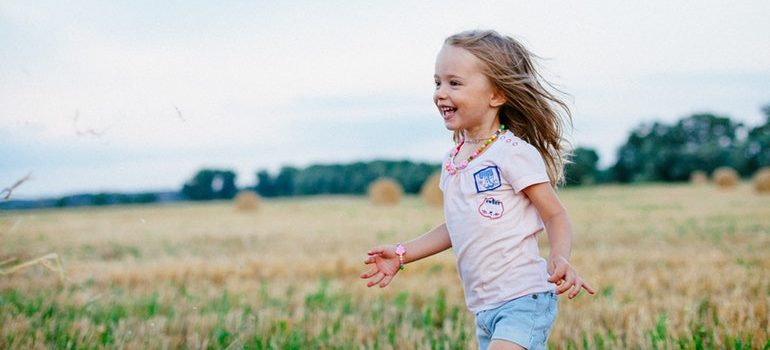 Girl running in a field.