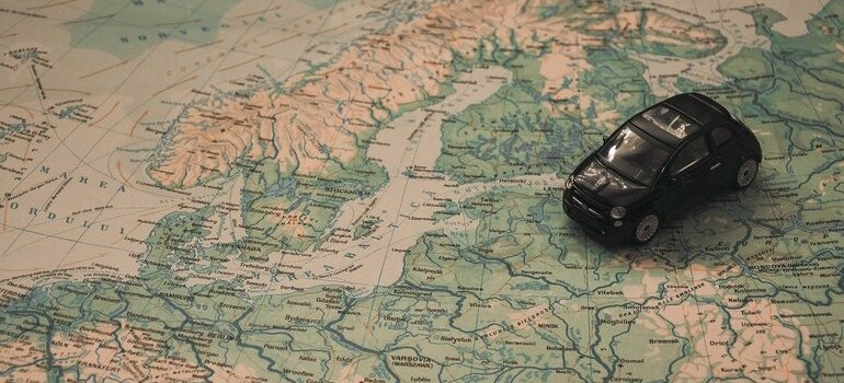 A toy car on a map of Europe