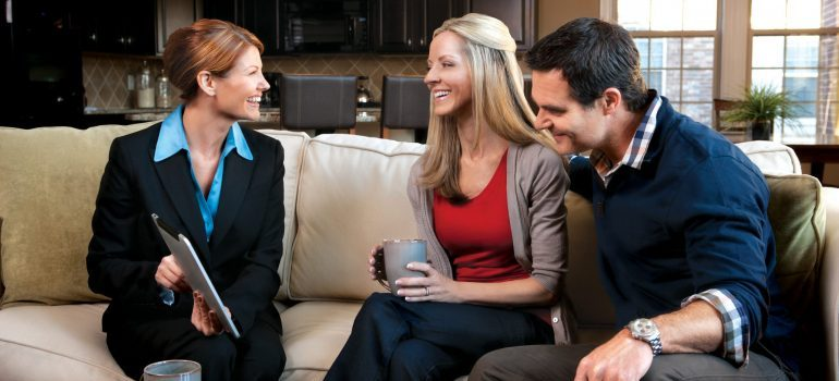 Couple with Agent on Couch showing them moving quotes NJ