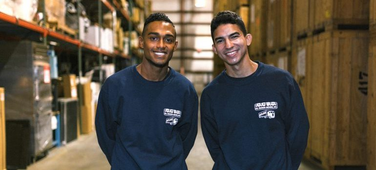 storage services NJ - two movers in a storage facility